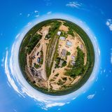 Little planet panoramic aerial view from drone to sand pit. Russia Stock Photo