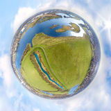 Little planet from a river country Stock Photos
