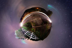 Little Planet Rural Roadside at Midnight. Little planet projection of roadside 360 panorama at night with Milky Way visible Stock Photo