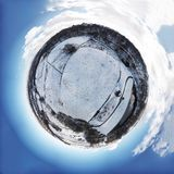 Little planet snow covered fields. Image manipulation little planet snow winter cold ice blue sky earth landscape royalty free stock photography