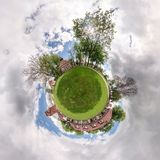 Little planet. Spherical aerial view in a field in beautiful day with nice clouds royalty free stock images