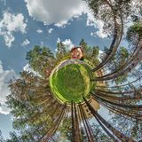 Little planet. Spherical aerial view in forest near vacation home in nice day with nice clouds stock images