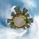 Little planet. Spherical aerial view with skyscrapers in beautiful day with nice clouds royalty free stock image