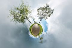 Little planet spherical panorama 360 degrees. Spherical aerial view in field in nice day with awesome clouds. Curvature of space. stock illustration