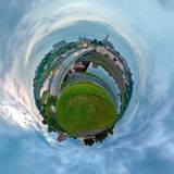 Little planet. Spherical view of Bridge over the river to the city at sunset stock photography