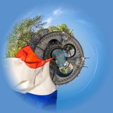 Little planet view of Cruising on a peniche boat in Paris in spring, with a bridge and french flag in the foreground stock image