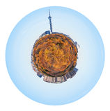 Little planet with yellow autumn forest and houses Royalty Free Stock Image