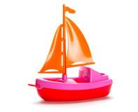 Little plastic toy ship. On white background royalty free stock image
