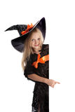 Little Playful Witch Holding a Sign Stock Images