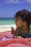 Little Polynesian girl at the beach Stock Images