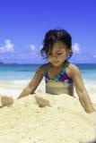 Little Polynesian girl at the beach stock photo