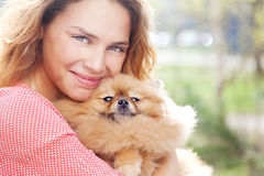 The little Pomeranian dog and pretty woman Royalty Free Stock Photo