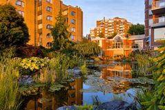 Little pond in front of residential building Stock Photography