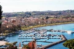 The little port of Capodimonte on Bolsena lake. View of Bolsena lake and little port of Capoddimonte , Lazio, Italy stock images