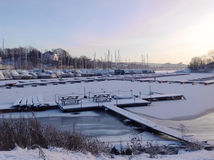 Little port in Norway covered with the snow. Royalty Free Stock Photo