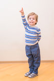 Little positive boy standig Royalty Free Stock Image
