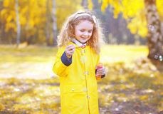 Little positive child having fun outdoors in autumn park Royalty Free Stock Photos