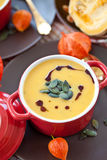 Little pot with pumpkin soup Stock Image