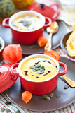 Little pot with pumpkin soup Royalty Free Stock Photos