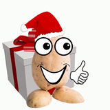 Little potato man with big gift Royalty Free Stock Photos