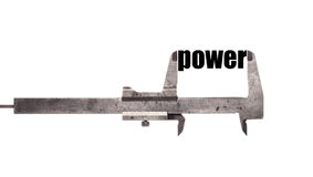 Little power. Color horizontal shot of a caliper measuring the word power stock image