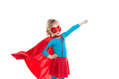 Little power super hero child (girl) in a red raincoat. Stock Photography