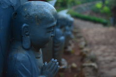 Little praying buddha. A japanese inspired park Stock Photo
