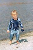 Little preschool boy playing on beach outdoors Stock Photo