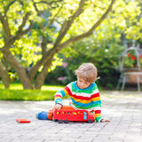 Little preschool boy playing with car toy Royalty Free Stock Images