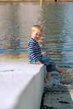 Little preschool boy posing on beach outdoors Royalty Free Stock Photo