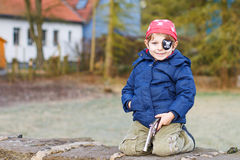 Little preschool boy of 4 years in pirate costume, outdoors. Royalty Free Stock Photography