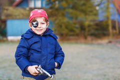 Little preschool boy of 4 years in pirate costume, outdoors. Royalty Free Stock Image