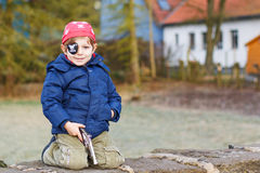Little preschool boy of 4 years in pirate costume, outdoors. Stock Photo