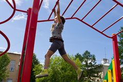 Free Little Preschool Girl Hanging Walk Along The Monkey Bars Stock Photography - 112924552