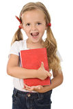 Little preschool girl holding books stock photo