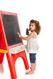Little Preschool Girl Writing on Blackboard Royalty Free Stock Image