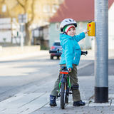 Little preschool kid boy riding with his first green bike Royalty Free Stock Photos