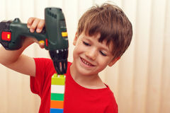 Little preschooler boy build construction Stock Image
