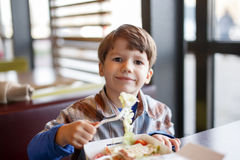 Little preschooler boy eating salad Stock Photo