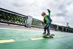 Little preschooler boy learning rollerskating Royalty Free Stock Photos