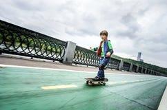 Little preschooler boy learning rollerskating Royalty Free Stock Images