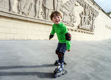 Little preschooler boy learning rollerskating Stock Photography