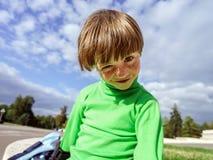 Little preschooler boy learning rollerskating Stock Image