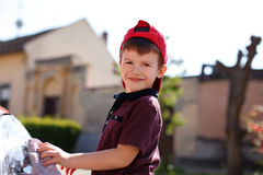 Little preschooler boy wash car outdoor Stock Image