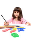 Little preschooler drawing or writing Stock Image