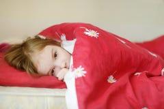 Little preschooler girl in bed Royalty Free Stock Photos