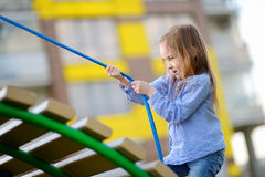 Little preschooler girl having fun with a rope Royalty Free Stock Photo