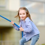 Little preschooler girl having fun with a rope Royalty Free Stock Photography