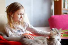 Little preschooler girl in pajamas and her cat Stock Photography