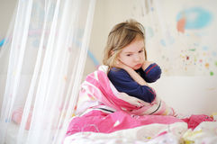 Little preschooler girl in pajamas on morning Stock Photo